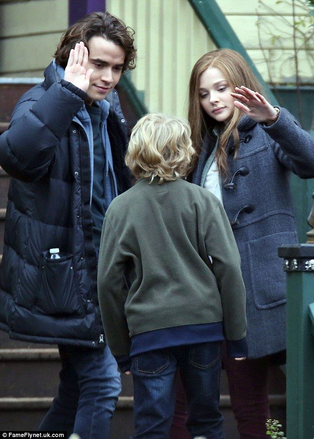 On-screen romance: Chloe Moretz laughed with her on-screen boyfriend Jamie Blackley on the set of If I Stay on Saturday in Vancouver, British Columbia.