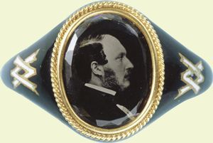 Mourning ring showing a photograph of Prince Albert.  This ring was commissioned and worn by Queen Victoria. Note their interlocking initials.