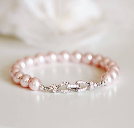 Elegant and Stunning Blush Pink Bracelet Blush Wedding Jewelry Pink Bridesmaid Gift Bridesmaid Bracelet Swarovski Pink Pearl Bracelet Bridal Party Gifts cubic zirconia clasp bracelet. This original design was created by Dream Island Jewellery Made with: * Rhodium plated over