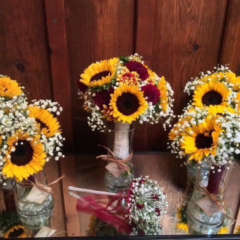 Sunflower, babies breath and dahlia bridal bouquet from Seasonal Celebrations.
