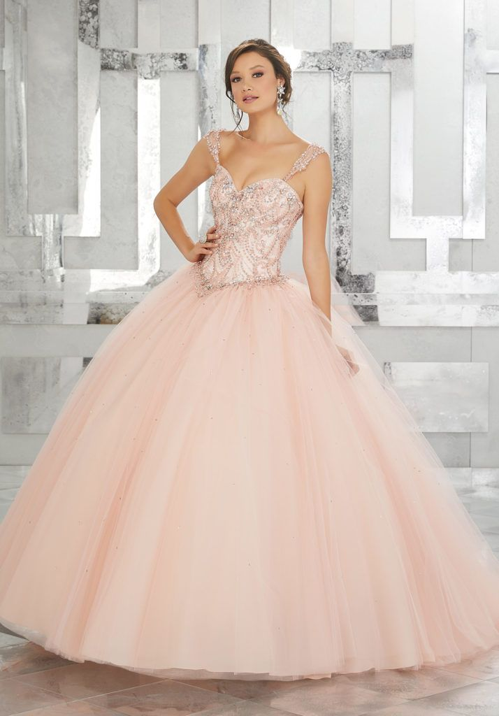 Quinceanera Dresses by Morilee designed by Madeline Gardner. This Stunning Tulle Quinceañera Ballgown Combines an Exquisitly Beaded Bodice with Full Tulle Skirt