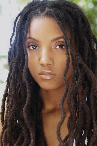 beautiful black melanated woman with dreadlocks