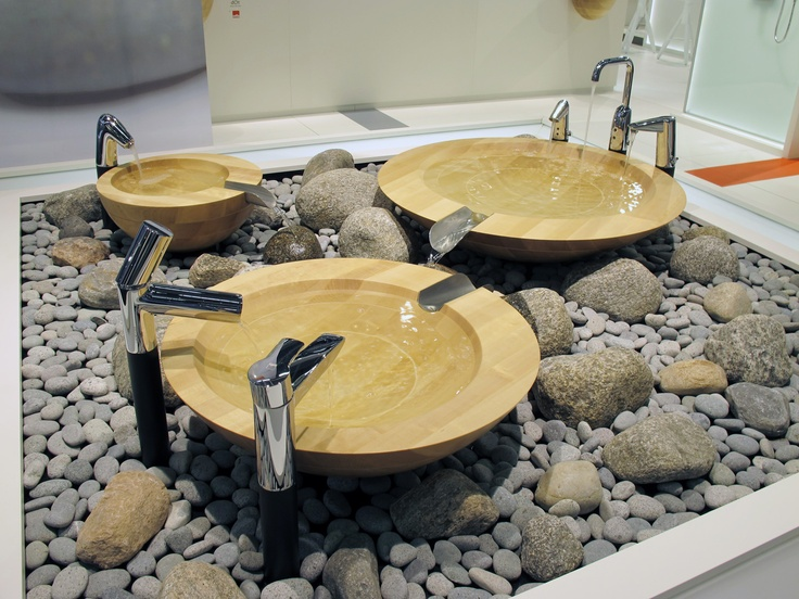Oras faucets with wooden basins at Oras fair stand