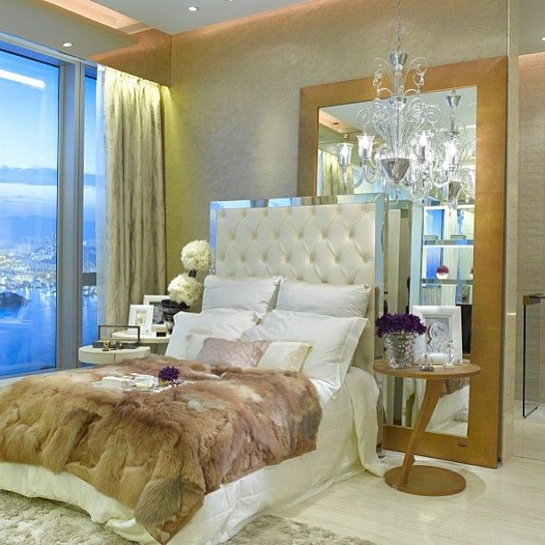 Love THAT tufted headboard with mirrored trim!