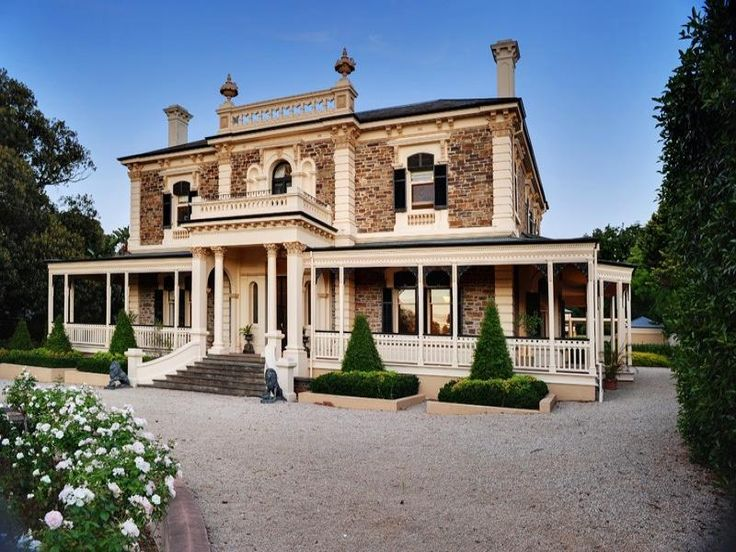 Brick victorian house exterior with balustrades & hedging - House Facade photo 525217