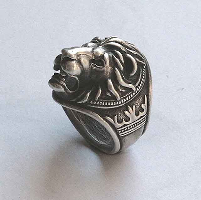lion head ring by yurikhromchenko on Etsy. $135.95, yikes. Expensive. Pair with a few other clunky rings