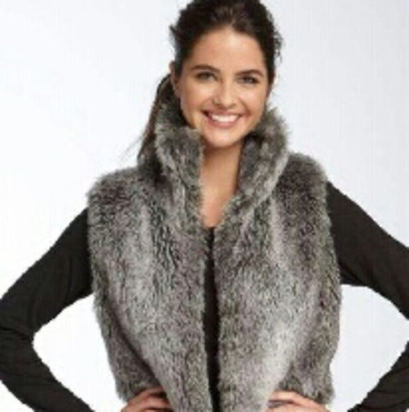 """Clique Couture Fur Vest Coat NWT Gray tone, hook closure, faux fur vest coat.  Has pockets,  hook closure even the neck for that funnel style.  Well made, Very soft.  New with tags. Size small Bust 20"""" Roomy for those thick sweaters. Clique Couture Jackets & Coats Vests"""