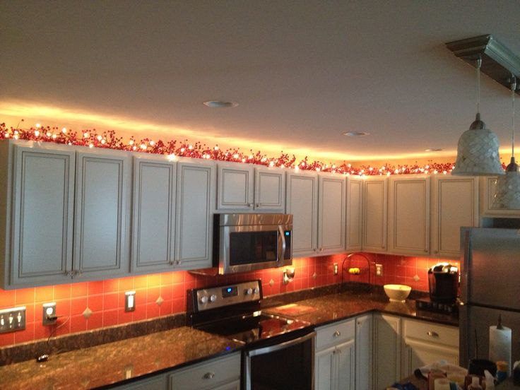 Here Is An Idea For Mood Lighting In Your Kitchen. Wrap Faux Berry Vines  With Brown Wired String Lights.and Viola Warm And Cozy Glow For Your Kitchen .