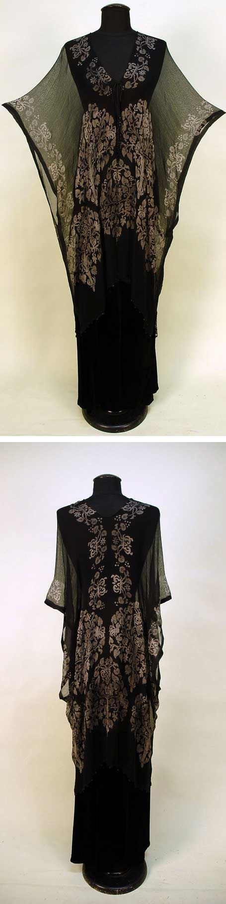 Stencilled black silk gauze tunic, probably Gallenga, 1920s. Square-cut wrap with silver Renaissance-style trees and stylized creatures. Black Venetian glass beads along hem and knotted cord closure with glass bead tassels. Whitaker Auctions