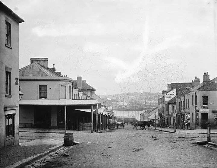 King St,Sydney,looking west from Kent St in 1870.Newton's Bakery at number 28-30,Star of Peace Hotel and E.Ryan Store.Photo from State Library of NSW.A♥W