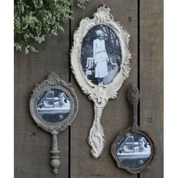 I'm IN LOVE! New vintage style hand mirror photo frames! Easy to mix and match, use them in a grouping with other different types of frames or hang one just by itselfsimple vintage style. $18 https://www.acottageinthecity.com