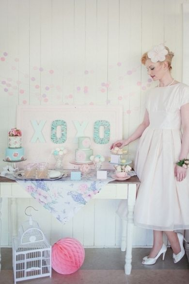 A 1950s-themed bridal shower calls for a birdcage fascinator and plenty of pastel-colored sweets. #Weddings #BridalShower