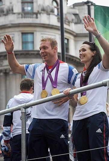 British Olympic gold medal winning cyclists Sir Chris Hoy and Victoria Pendleton wave to the fans during the London 2012 Victory Parade