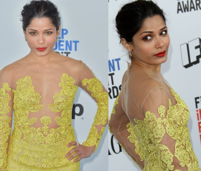 Freida Pinto styled her hair in an updo to show off her diamond earrings from Harry Kotlar