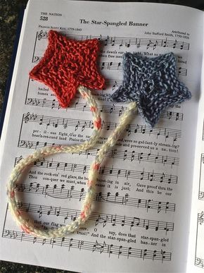 Free Knitting Pattern for Star Spangled Bookmark - Two stars knit on straight needles joined by an i-cord. Designed by Faith Schmidt