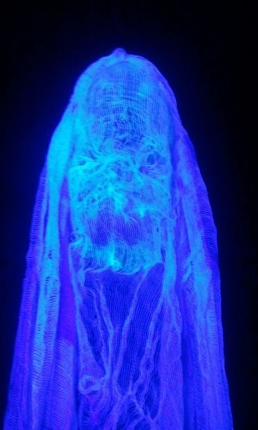 Halloween party / haunted house: Scary screaming glowing ghost