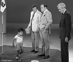 Tiger Woods age 3 with Bob Hope and Jimmy Stewart  On one program, Barry Goldwater played his trombone, and on another, a 3-year-old golf prodigy named Tiger Woods putted on stage. Douglas often had co-hosts who would spend an entire week on his show, everyone from Barbra Streisand to Sammy Davis, Jr. to Joan Crawford and Joyce Randolph. Co-hosts helped interview guests in exchange for spending an entire week -- instead of just a few minutes -- plugging their latest projects.
