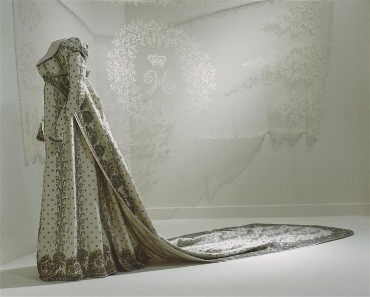 "Court Robe with Train (different view) belonging to the Empress Joséphine, Attributed to to the ""Couturier"" Louis-Hippolyte Leroy: ca. 1804–1814, French, silk, embroidered in metallic threads in twigs, branches, lotus flowers and carnations (embroidered by Towers and Son), crystal cabochons."