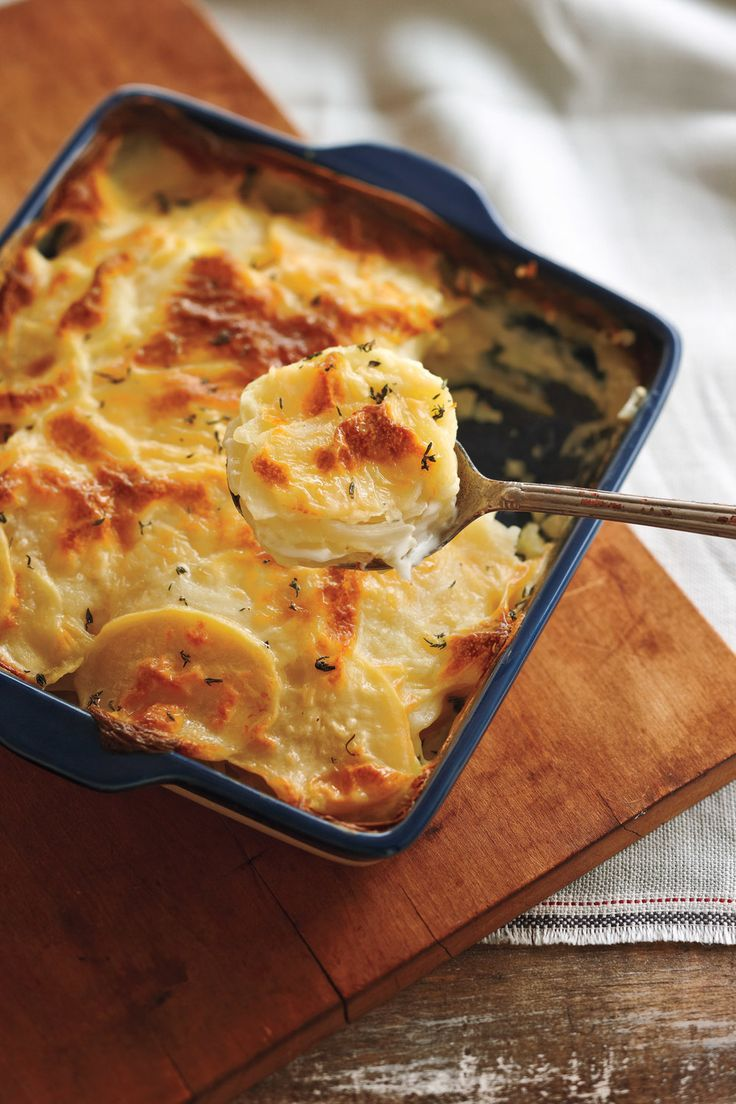 With a nice hint of garlic, these potatoes are a delicious addition to any meal and are much lighter than those with a cream-laden gratin. To slice them easily, cut a little piece off the bottom of each potato to stabilize it on the cutting board. Serve w
