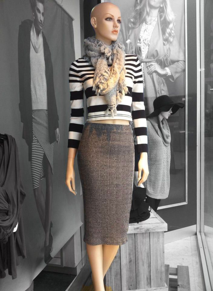 A must-have this Autumn/ Winter - midi-style ribbed skirt. Fitted with stretch.