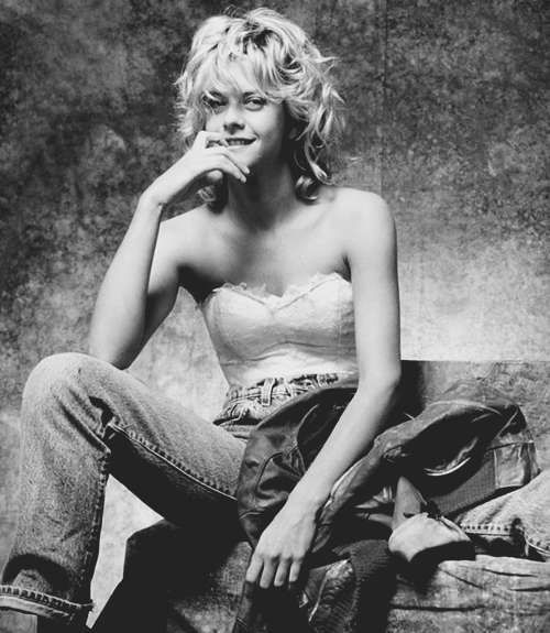 Young Meg Ryan in Gray Jeans and a White Blouse