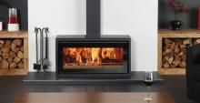Stovax wood heater - freestanding. Great wood storage boxes.