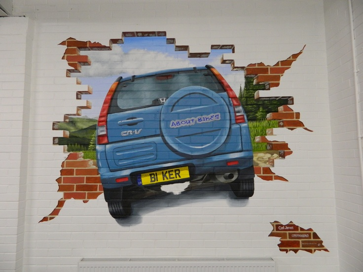 life size car crashing through wall painted using acrylic