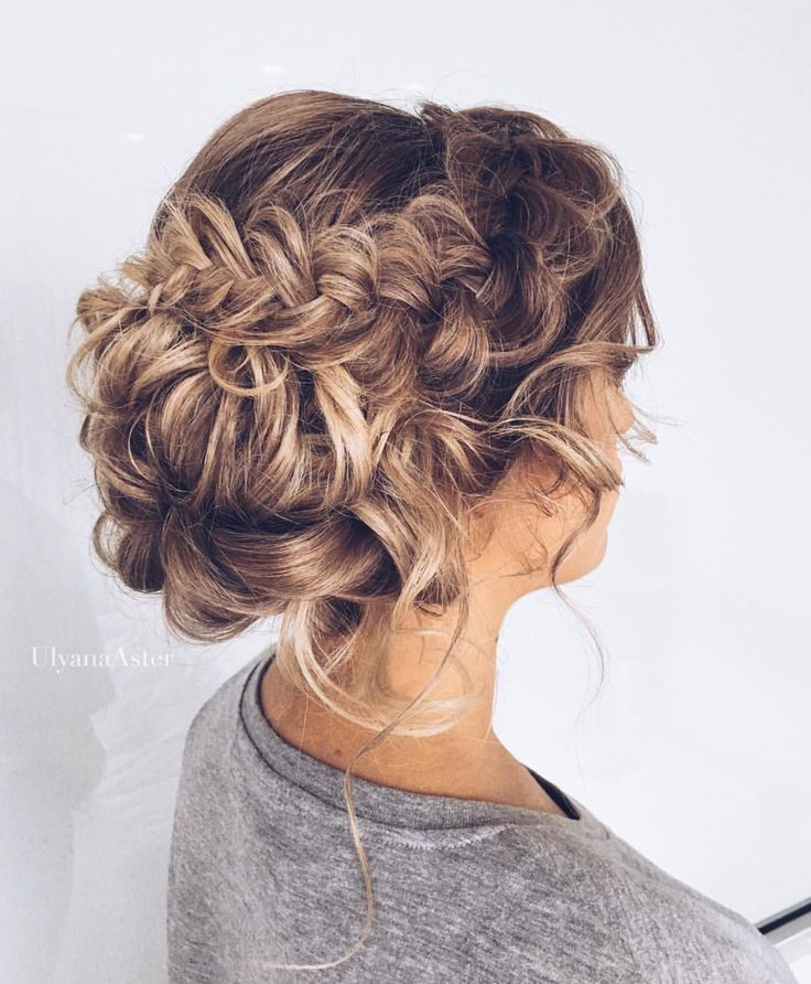 Gorgeous braided updo with curls; this is perfect for a wedding.