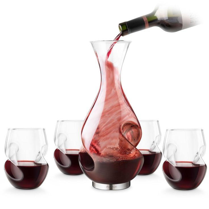 L'Grand Conundrum Decanter Set by Final Touch includes a unique wine carafe with 1 wine bottle capacity and 4 mouth blown wine glasses.
