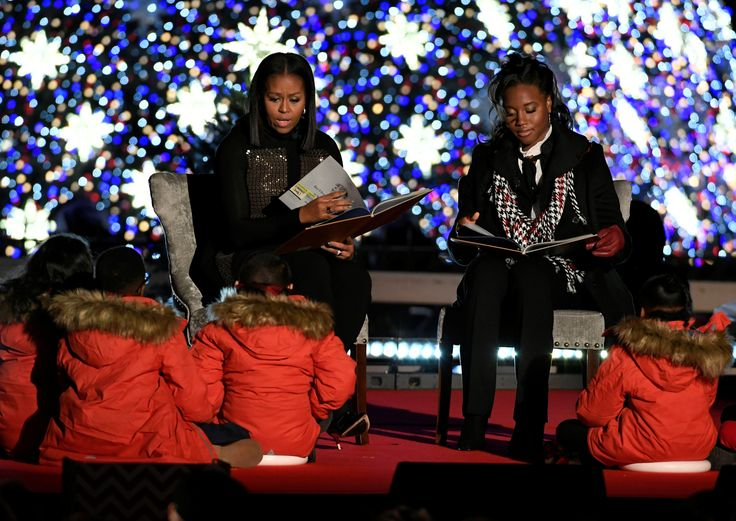First Lady Michelle Obama and U.S. Olympic swimming gold medalist Simone Manuel read 'The Night Before Christmas' to children at the 94th Annual National Christmas Tree Lighting ceremony on The Ellipse, near the White House, in Washington, U.S., December 1, 2016. (REUTERS/Mike Theiler)  via @AOL_Lifestyle Read more: http://www.aol.com/article/2016/12/24/obamas-revisit-first-christmas-address-while-delivering-last-hol/21641624/?a_dgi=aolshare_pinterest#fullscreen