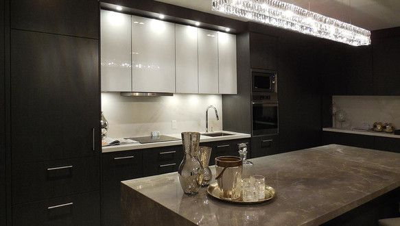 Dark and sleek kitchen at Minto Yorkville Park, 94 Cumberland Street, Yorkville, Toronto, ON is a new development project by Minto. Check out the property photos, floor plans and amenities. | REW.ca