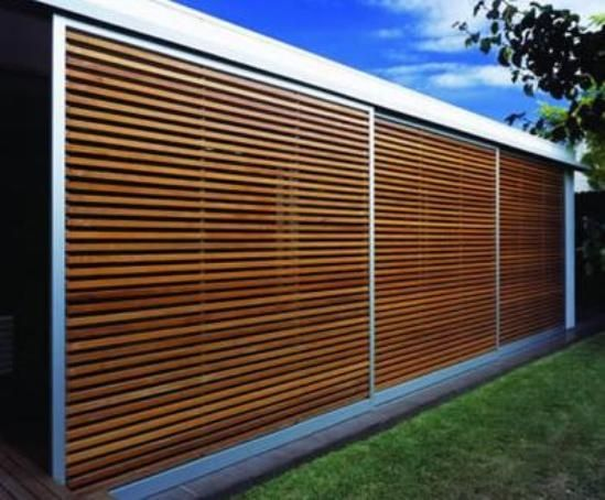 slatted fence maybe to hide garbage cans. Now that's what we're talkin about! Superior Fence.