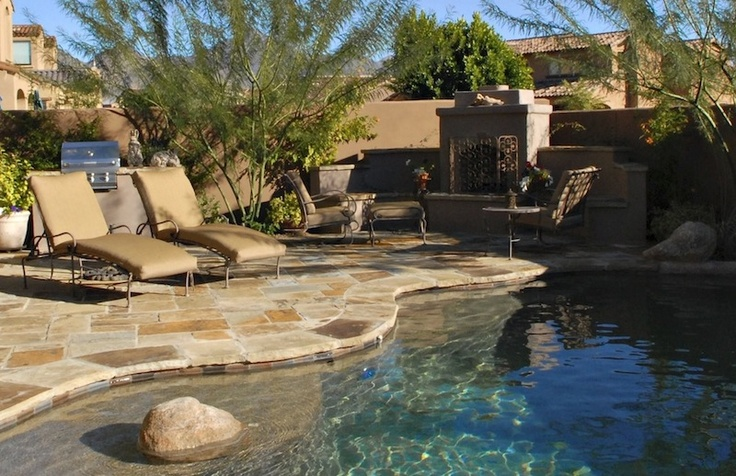 Look at this gorgeous pool in the backyard of a three bedroom, two bath home in DC Ranch