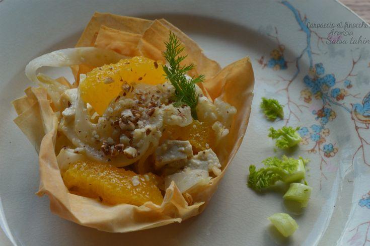 Carpaccio di finocchi, arancia e nocciole in salsa tahin