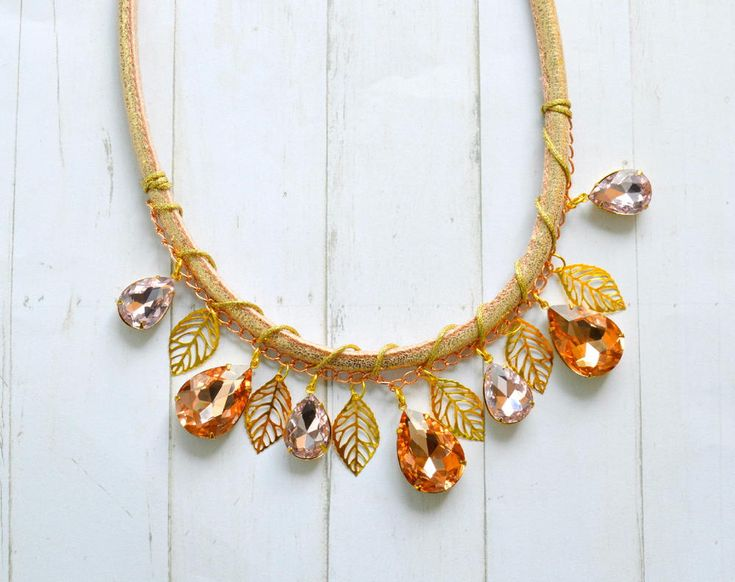 Wow! Feel like a woodland goddess with this Rhinestone and Cord Statement Necklace.