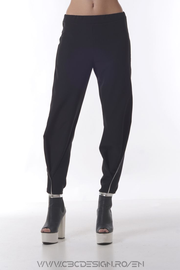 The ICICLE Pants have a strong reference to sport pants because of the top legging-like finish, but they keep a smart-casual look due to the suiting fabric. They rock a silver insertion that descends elegantly from the side of the leg to the front, thus accentuating the subtle beauty of the elongated legs.