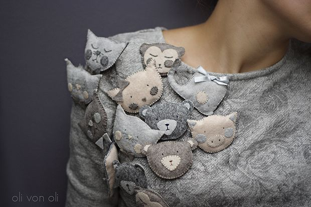 I had no idea where to put these felt (?) brooches.  but they are SO wonderful and look great worn in a grouping.