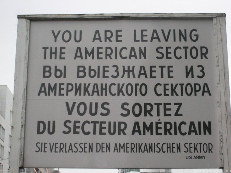 Checkpoint Charlie is the famous border crossing between East and West Berlin, where American and Russian forces stood against each other after the creation of the Berlin wall on August 13, 1961.