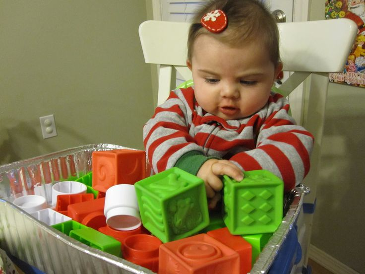 Infant Activities: First Sensory Tub - they love the colors, shapes and textures!