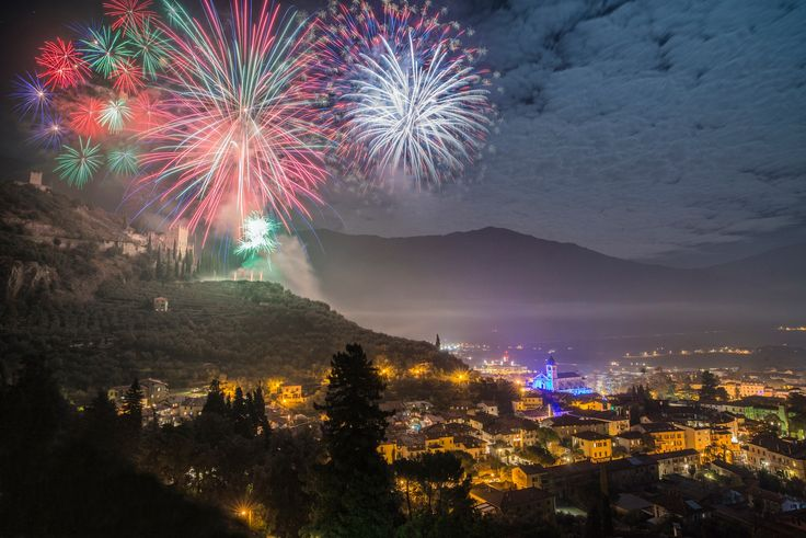 Fireworks over the old castle - A nightscape of the small town of Arco di Trento, near lake Garda, northern Italy during a fireworks show over the castle.