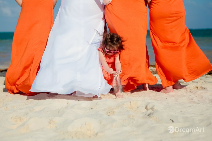 Little girl with Bride and Bridesmaids playing with sand at Moon Palace Moon Palace Golf & Spa Resort @palaceresorts #DreamArtPhotography #DreamArtWeddings #WeddingPhotography #Bride #Bridesmaids #Girl #WeddingDress Special thanks to @prweddings