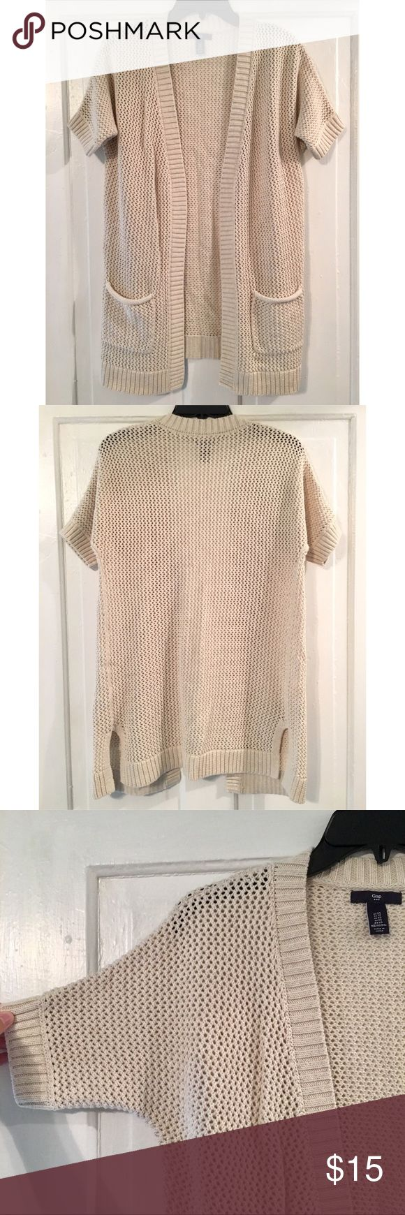 🎉Christmas Sale!🎉 Gap Short Sleeve Cardigan 🎉🎁🎄CHRISTMAS SALE!!🎄🎁🎉  Gap Short Sleeve Tunic Knit Cardigan Size Extra Small (also fits size small) 31 inches long Cream Color Two Front Pockets Excellent Condition!  **Sale ends on January 1st, 2018** GAP Sweaters Cardigans