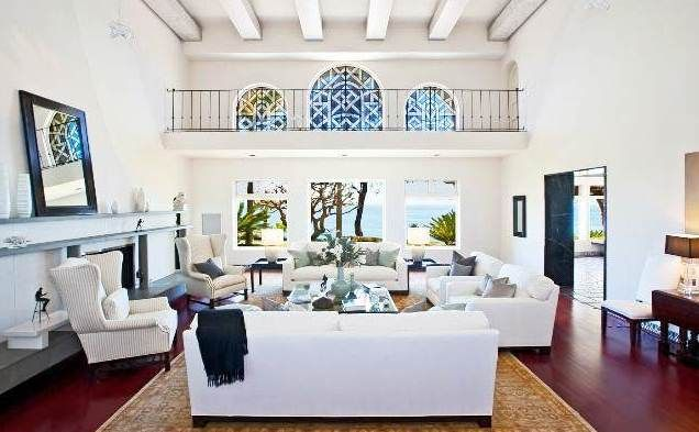 The Living Room In A 45 000 000 Malibu Mansion Is All White With Exposed Beams Ocean Views And