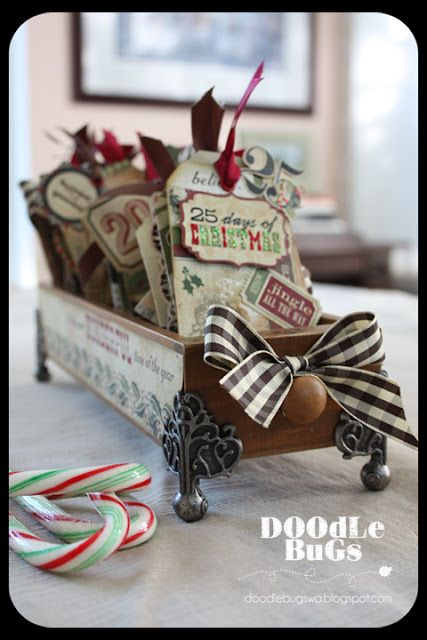 Doodlebugs: Simple Stories & 7 Gypsies - It's a beautiful Christmas Countdown Calendar filled with 25 seasonal activities.  Each tag has a pocket on the back.  The pocket has a small tag tucked inside with a fun activity that ties in with Christmas.