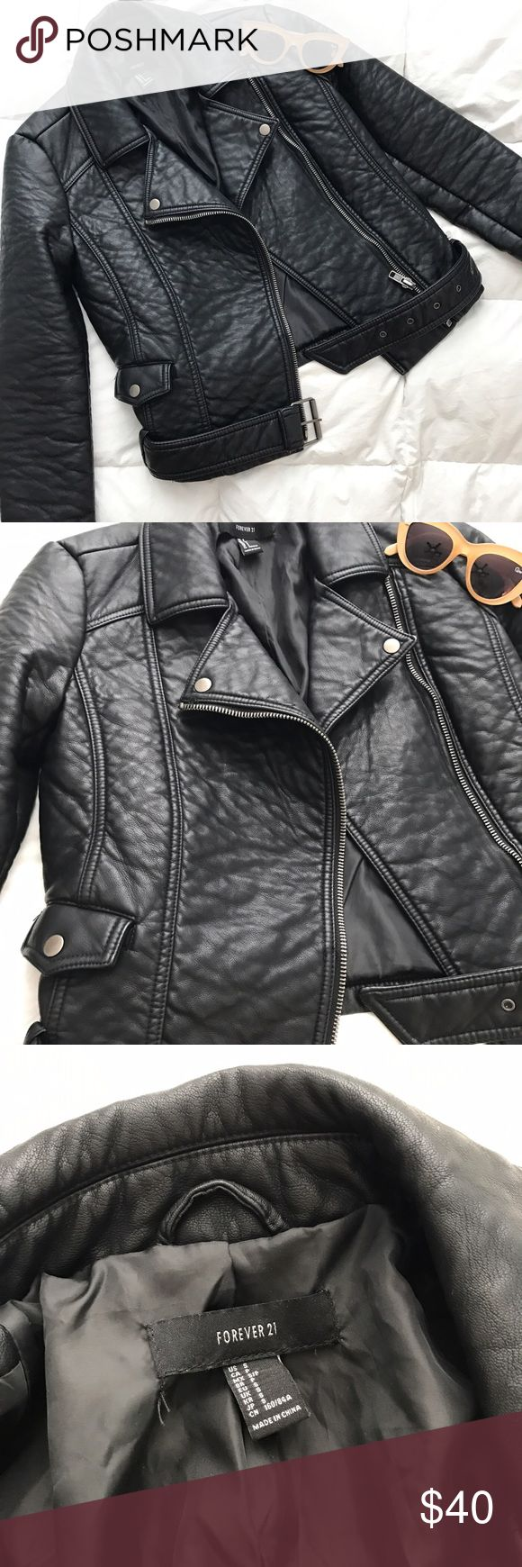 Forever 21 Black Faux Leather Jacket Faux leather Moto leather jacket. This jacket is amazing! Like new. Worn maybe 3 times. No flaws. Removable belt. Gunmetal detailing. Fits a 4 best. Sold out everywhere! Forever 21 Jackets & Coats