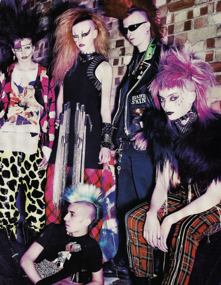 More staples of punk fashion- bright, garish coloured hair, spikes, chains, pattern trousers/leggings/skirt (tartan was, and still is, particular popular) and of course, the infamous Mohawk.