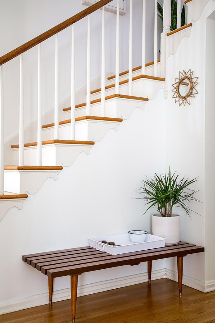 a minimalist bench paired with thoughtful staircase detailing.