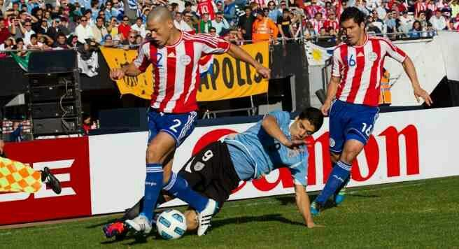 Uruguay 3 Paraguay 0 in 2011 in Buenos Aires. Luis Suarez tracks back to tackle Dario Veron in the Final of Copa America.