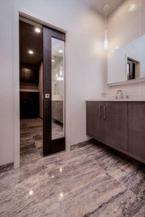 HighCraft Builders master bath remodel with mirrored pocket door.
