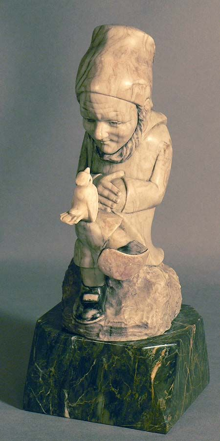 marple statue of a dwarf converses with a bird.